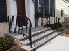 wrought iron railings curving away from the top step. i like how this opens up t… wrought iron railings curving away from the top step. i like how this opens up the steps Railings For Steps, Porch Step Railing, Wrought Iron Porch Railings, Porch Handrails, Exterior Handrail, Outdoor Stair Railing, Iron Handrails, Front Porch Steps, Hand Railing