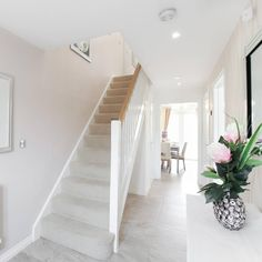 This neutral hallway is light and bright ☀ taylor wimpey, house entrance, e Bright Hallway, Hallway Colours, Entrance Hall Decor, House Entrance, House Staircase, Staircase Design, Modern Staircase, Hallway Designs, Hallway Ideas