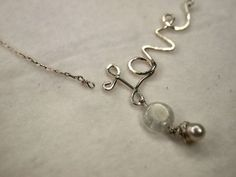 How to make a 'love' necklace