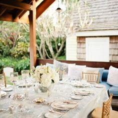 Mercury glass, white flowers and crystal chandeliers add elegant island charm to an outdoor @Four Seasons Resort Nevis, West Indies tablescape.