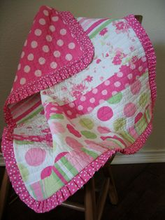 Quilt with ruffle binding. Cute.  Quick.  Easy!