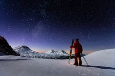 Skier Ari Delashmutt relaxes after a long day of skiing under a blanket of stars, Broken Top Mountain, Oregon.