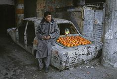 An Iraqi boy selling oranges in a Baghdad during the Gulf War, circa 1991.