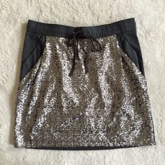 """❤️ V DAY SALE Sequin Knit Skirt by Ann Taylor Dazzling sequins adorn the front of this clever pocket skirt for modern glam. Drawstring waistband with elastic at the front and back for a comfortable but stylish look. Front off-seam pockets and lined front panel. Size M. Laid flat, waist is 17"""" across and it is 18.5"""" long. There is also some stretch to the waist. NWT – never worn. Thanks for looking! ❤️ V DAY SALE! PRICE GOES BACK UP 2/15! Ann Taylor Skirts"""