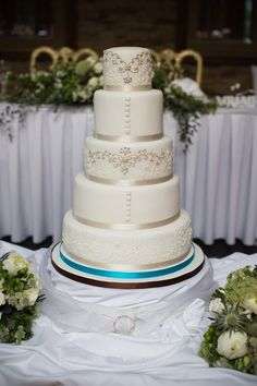 Hand-piped filigree five tier by cakesbyjames.