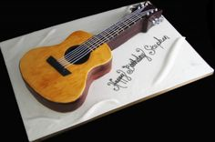 Music & Rock Theme Party Ideas - Guitar Cake by Butterfly Bakeshop - Mazelmoments.com
