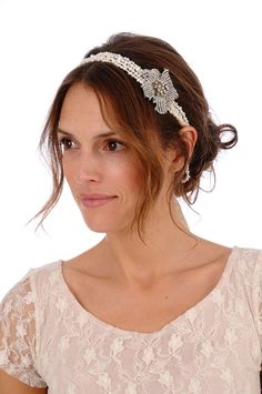 Lux Collection - A double strand of ivory fresh water pearls is accented with our signature encrusted lily brooch making this headband the perfect finishing touch for a vintage inspired look. The pearls are attached to a luxurious double faced satin ribbon in the color of your choice.    2 x 20 inch...    $218
