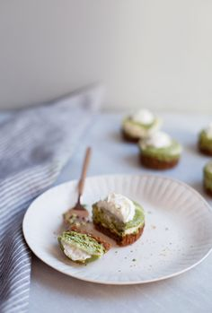 These Mini Matcha Swirl Cheesecakes are baked onto a gingersnap crust! #matcha #dessert #cheesecake