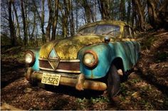 We have gathered quite a few photos of abandoned cars from all over the world.  Some were left in the woods after the war, others abandoned at random places and times without any proof of where they came from or why they were left there.