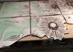 Glazing the sunflower mural at Natalie Blake Studios ~ handmade hand carved custom ceramic porcelain tiles with shaped edges for the exterior mural at Jewish Family Services in Houston, TX 2016