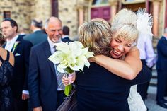 We receive so many hugging submissions but this one caught our collective eye because of the bride's utterly joyful expression! Photo by JonMarkPhoto in Victoria, Canada.