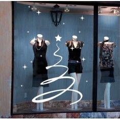 árbol de navidad muy original con estrellas. Este vinilo decorativo es perfecto para colocar en escaparates