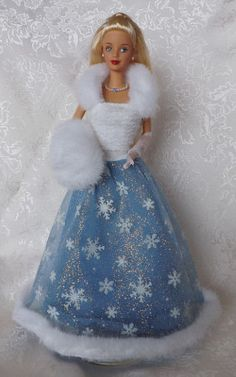 Barbie looks like Elsa in her white snowflake dress FROM: http://media-cache-ak0.pinimg.com/originals/6f/bd/98/6fbd98e0c68b9dc433861312d9d36581.jpg