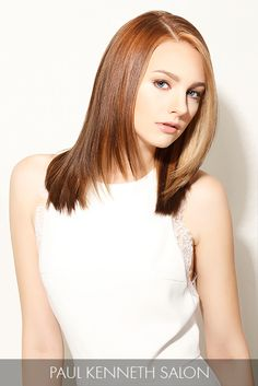 Long layers and a front angle lend a fashionable twist to sleek strands, making it one of summer's sexiest hair moves.