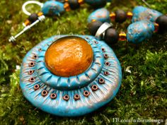Blue and orange polymer clay talisman   https://www.facebook.com/nibirudesign