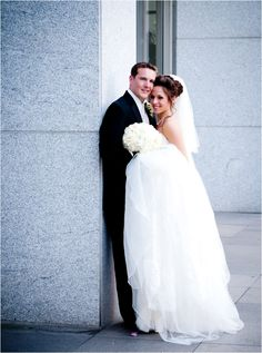 Bride and groom photo session outside of the Petroleum Club Houston. Photo by SB Image Studios