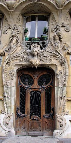 Art-Noveau style building built in 1901, at 29 Ave Rapp, in Paris. Designed by architect Jules Lavirotte, with a door by sculptor Jean-Baptiste Larrive. Click through to read more about it! via http://www.ipreferparis.net/2010/11/door-of-the-month-29-ave-rapp.html