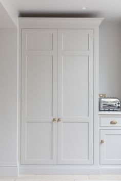 The cook's pantry at the Victorian family home provides masses of storage for dry ingredients as well as housing the freestanding microwave which is always a fantastic option when you want to keep integrated appliances to a minimum in order to maximise storage space in the main kitchen. #humphreymunson