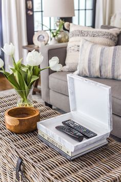 How to wrap a cigar box with contact paper to repurpose into a decorative remote control holder for a coffee table. #remotecontrolholder #coffeetabledecor