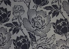 Peony Wallpaper Large peony print wallpaper in black on a dark greeny grey background.