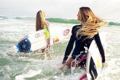 Alana Blanchard and Nikki Van Dijk  catching waves off the Gold Coast of Australia. Photo by @trentmitchellphoto