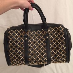 Black and gold stud purse Black purse with gold stud details. Adjustable shoulder strap that is also removable. Outside back zip pocket. Top zip closure. Inside compartment pockets and middle pocket divider with top zip. Great condition! Bags Satchels