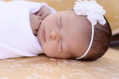 $8.95 Darling soft White flower with a Swarvorski Ivory pearl sewn in the center on a skinny elastic headband