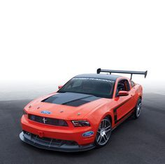Ford Racing Mustang Boss 302S factory-built race car, ready for track days and road racing in a number of SCCA and NASA classes.    2013 Mustang Boss 302S body color choices are: White or School Bus Yellow.   Note: 2012 Boss 302S in Competition Orange is shown.    2013 Build limited to 50 units