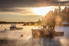 Sea smoke rises among several lobster boats in the small fishing village of Five Islands. The warm glow of the sun belies the extreme cold necessary to create this dramatic ocean mist. Lobster Boat, Boothbay Harbor, Fishing Villages, Maine, Coast, Ocean, Clouds, Smoke, Islands