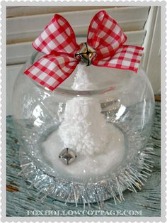 """Dollar Tree Christmas Snow Globe {tutorial} -- See how to easily make a (waterless) Christmas Snow Globe, or """"faux globe"""" with this {tutorial} at Fox Hollow Cottage. Makes an affordable gift or home decor."""