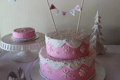 Banners with name, light blue snowflakes. Winter Onederland Cake! By Lori's luscious layers.