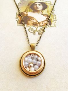 handmade vintage necklace code - 208 antique bronze round pendant decorated with white pearls and beads surrounded by a lovely handmade ring, long antique bronze chain   an-dorablelifeJWLS DiVe Into Style