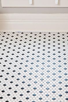 bathroom flooring with small hex tiles