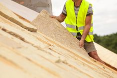 Roofer builder worker installing roof insulation material on new house under construction Woodworking Projects Plans, Teds Woodworking, Insulation Materials, Roof Insulation, Cork Panels, Soundproofing Material, House Under Construction, Oak Frame House, Noise Pollution