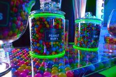 Glow sticks were wrapped around the candy jars at this neon Bar Mitzvah party. | MitzvahMarket.com