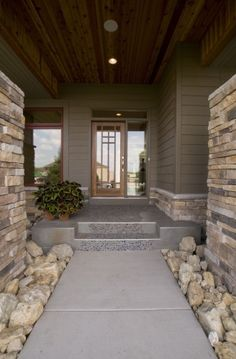 LOVE this front porch..kind of a tin stained color with pebbles cemented in down the center.