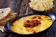 Get Queso Fundido with Chorizo Recipe from Food Network Queso Flameado, Queso Fundido, Fundido Recipe, Mexican Appetizers, Appetizer Recipes, Cheese Appetizers, Mexican Dishes, Mexican Food Recipes, Mexican Cheese