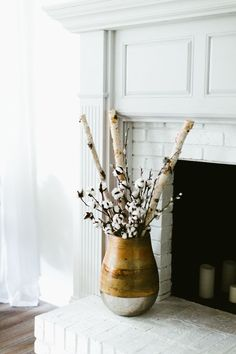 Southern Newlywed: At Home with Hope and Michael - Southern Weddings Birch Tree Decor, Log Decor, Birch Branches, Tree Branch Decor, Craftsman Remodel, Sunflower Kitchen Decor, Condo Living Room, Cotton Decor, Resin Artwork
