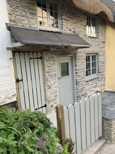 French Grey (Farrow and Ball) door, gates and windows. Cottage Front Doors, Cottage Windows, Grey Front Doors, Grey Exterior, Cottage Exterior, Grey Stone House, Rendered Houses, Oak Framed Buildings, Cottage Renovation