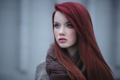 Red hair color and pale skin