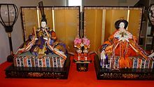 Hina-matsuri or Japanese doll festival/Girl's Day...families with girls display dolls representing the emperor and empress, attendants and musicians