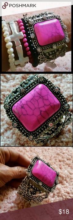 AJ Pink Stone Bracelet Sliver color hinged bracelet w/pink stone, embellished with clear rhinestones. Never been worn, still has tag. Lead & nickel safe. AJ Jewelry Bracelets