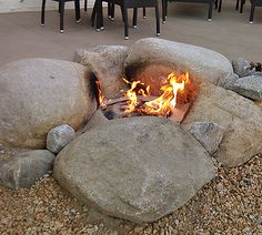 Blog post on how to build a fire pit. I love the natural boulder look.  #firepit  #fire