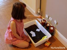 Sorting game. Using dyed rice, dig for letters the sort them into the correct plant pot.