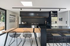 Black minimalist kitchen in compact holiday home