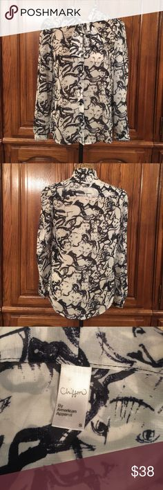 """American Apparel Chiffon Cat Print Blouse EUC size small made of 100% polyester. Button Down Whitt with tie bow at the neckline. It measures approximately 18""""flat underarm to underarm and measures approximately 24""""long measured from shoulder to hem and the sleeves measure approximately 24""""long American Apparel Tops Button Down Shirts"""