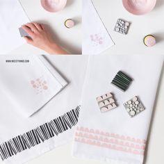 Deko-Ideen für den Ostertisch: DIY Eierbecher aus Holzringen, bestempelte Stoffservietten, Papierblumen aus Seidenpapier und Bunny-Cupcakes