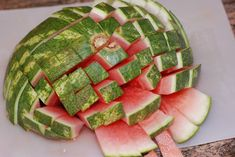 Cut your watermelon in half, than slices, then slice opposite to make watermelon sticks.  Good idea!