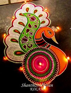 We have included beautiful diwali rangoli designs from shanthi's gallery. It's believed that rangoli designs started many centuries ago. Some refrences of rangoli designs are also available in our Rangoli Designs Peacock, Indian Rangoli Designs, Rangoli Designs Latest, Simple Rangoli Designs Images, Rangoli Patterns, Colorful Rangoli Designs, Beautiful Rangoli Designs, Easy Rangoli Designs Diwali, Free Hand Rangoli Design