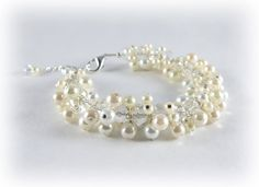 Pearl and Crystal Cluster Bridal Braclet- Chunky White and Ivory Pearl Wedding Braclet. $40.00, via Etsy.